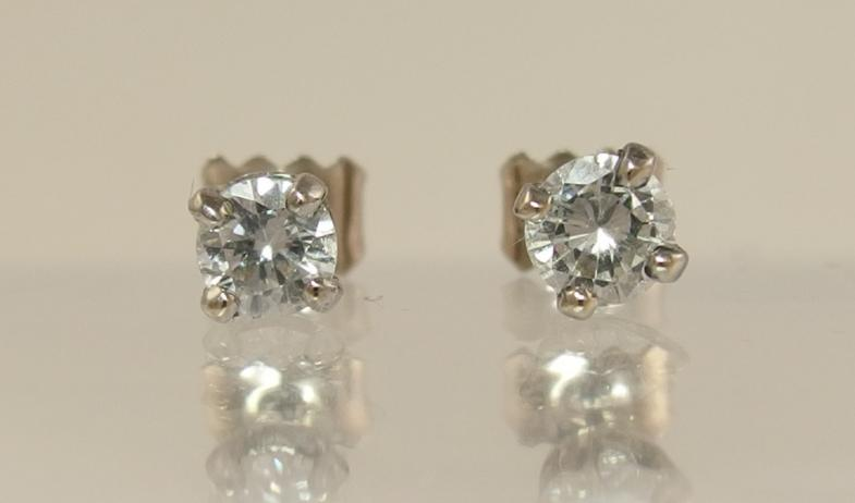 A pair of 18ct white gold diamond stud earrings of approx 0.60cts combined