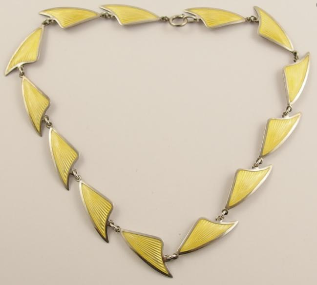 A silver and yellow enamelled necklace by Danish designer Brdr. Bjorklund