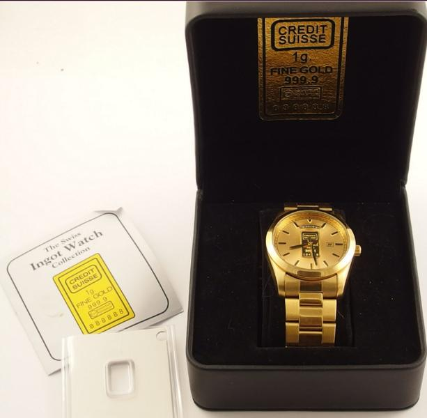 An ingot watch the dial set with a credit Swisse 1gm 999.9 fine gold ingot