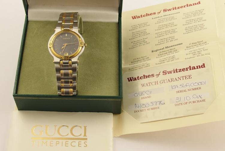 A gents Gucci gents 9000 M 0248309 stainless steel and gold tone watch, with original box and paperwork
