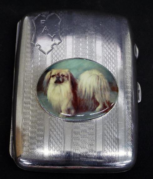 1920s silver hip shaped engine turned card case