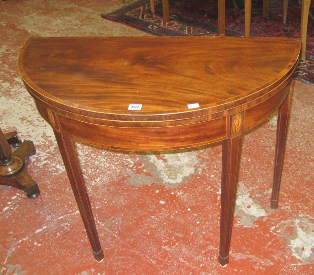 A late George III mahogany and cross banded demi-lune card table