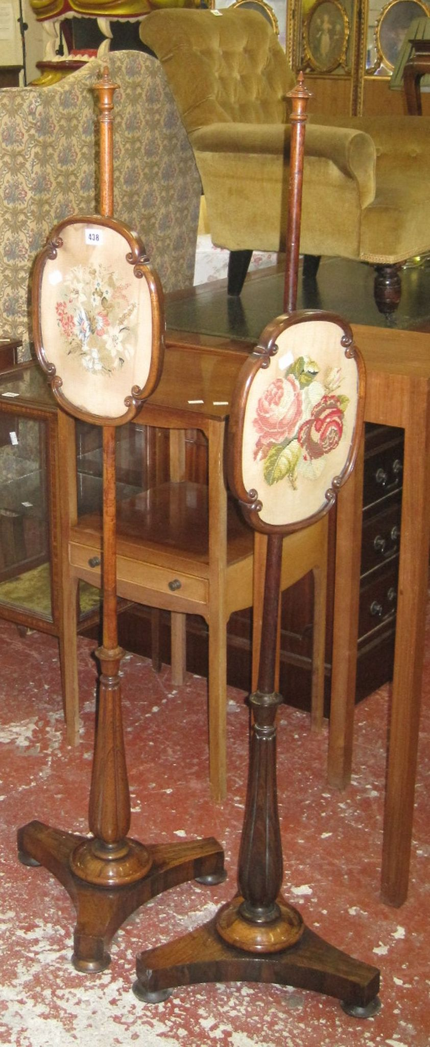 A pair of 19th Century rosewood polescreens