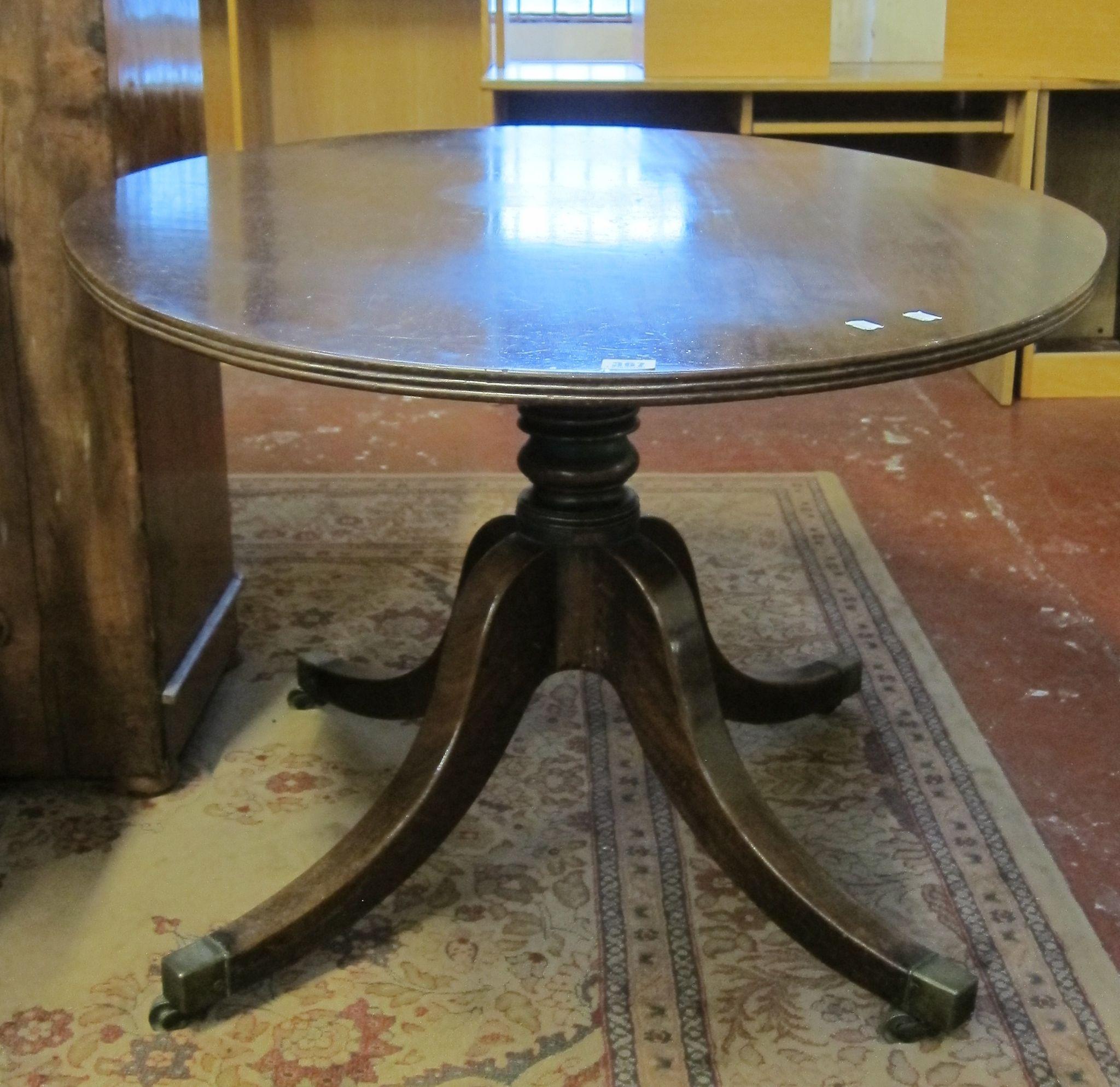 A 19th Century mahogany oval breakfast table