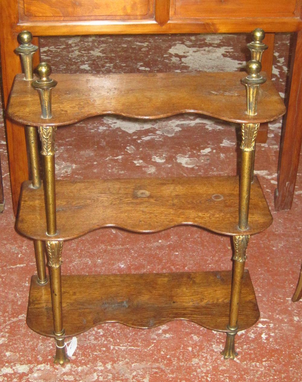 A set of three gilt metal and oak hanging shelves
