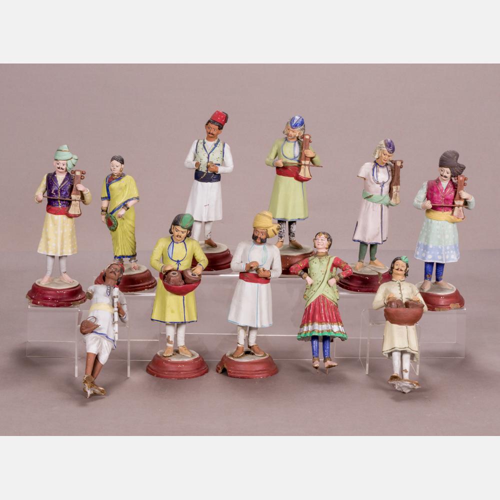 Eleven Ceramic Figures in Indian Dress