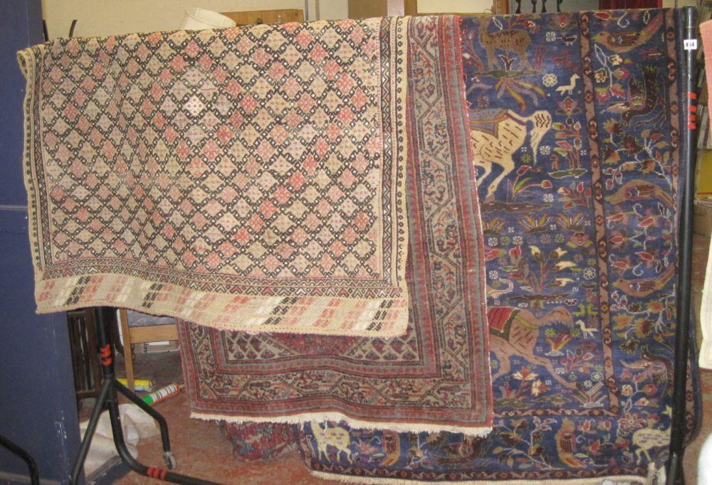 A Middle Eastern blue ground carpet