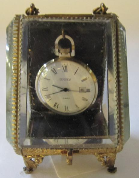 A Sekonda pocket watch in watch case