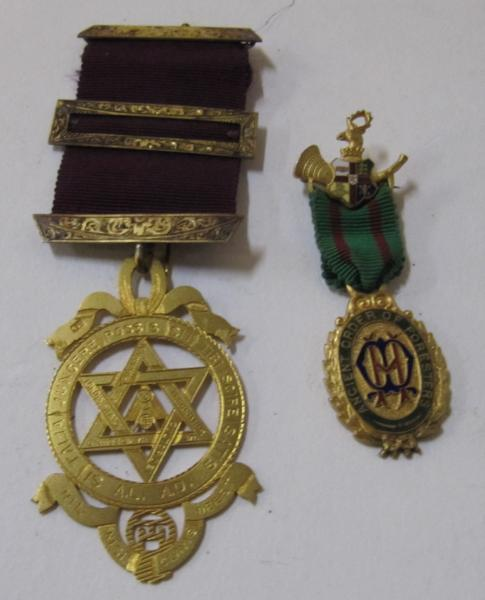 A lot comprising a silver gilt Masonic medal and a gilt medal Order of Foresters medal