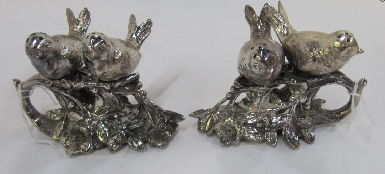 A pair of silver plated condiment stands modelled as pairs of birds sitting on branches