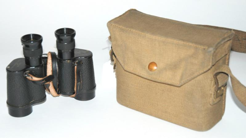 A pair of Kershaw binoculars in case and a Victorian photograph album with gilt metal clasp