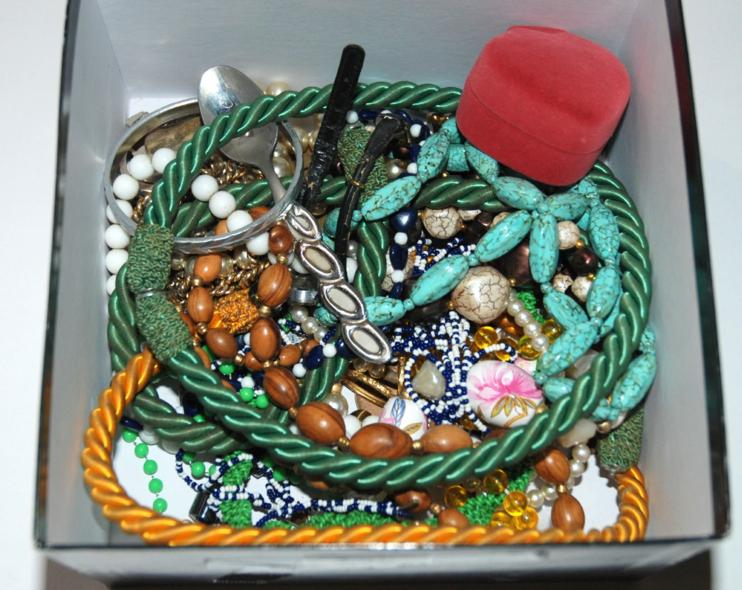 A box of various costume jewellery