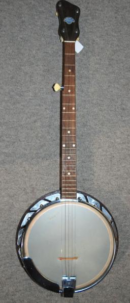 A four string banjo by John Grey & Sons