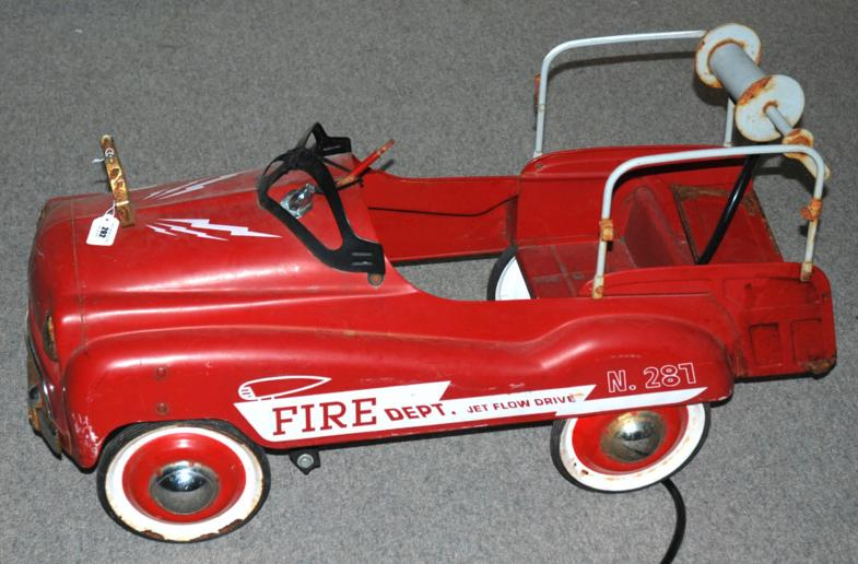 A Glide Ride red painted 1940's child's ride on fire engine, inscribed Fire Department, Jet Flow Drive, No. 281, lacking steerin