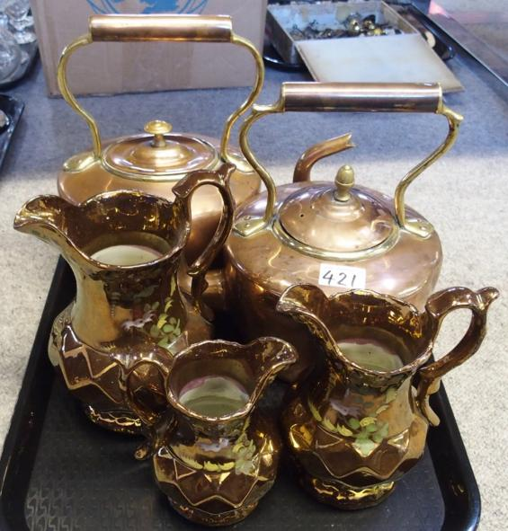 Two copper kettles and three copper lustre jugs