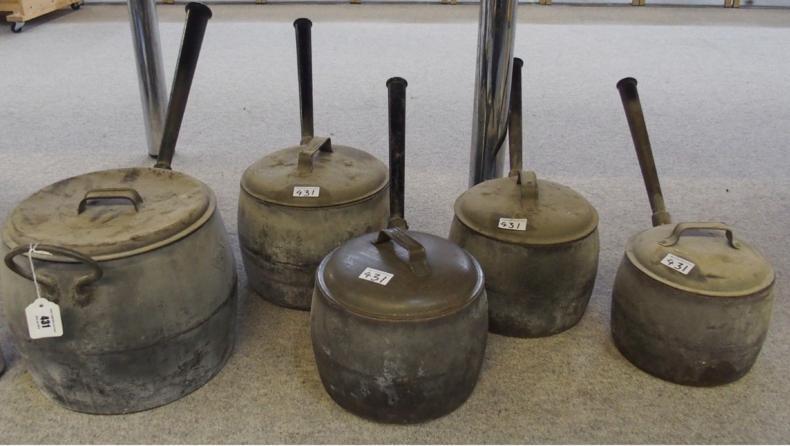 Graduated set of Kendrick cast iron saucepans.