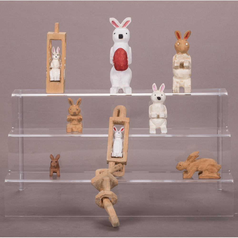 A Collection of Eight Rabbits