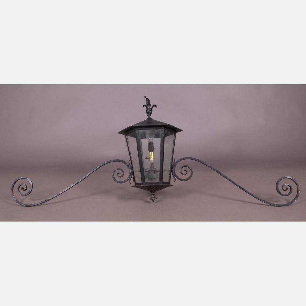 A Wrought Metal Hanging Light Fixture