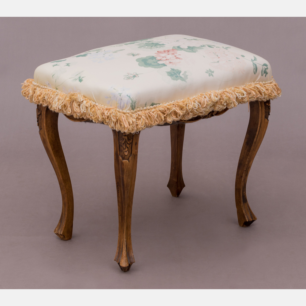 An Upholstered Footstool