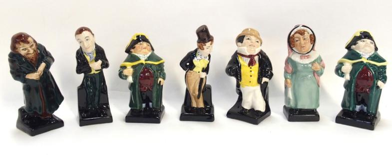 Seven Royal Doulton Dickens characters including Mrs Bardell, two of Bumble, Dick Swiveller, Captain Cuttle, Uriah Heap and Fagi