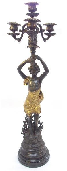 Figural metal candelabra on socle base.