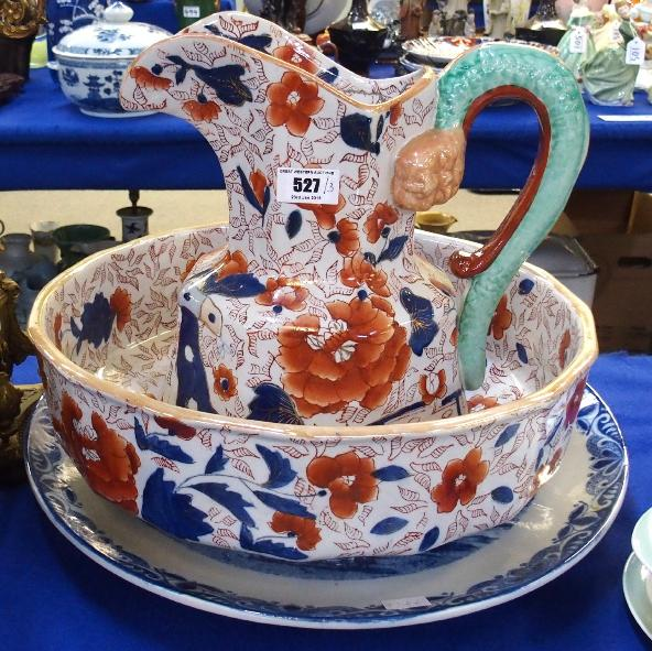 Ironstone Imari washbowl and ewer and a Delft blue and white platter.