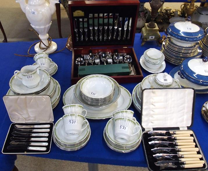 Noritake 'Greenpoint' dinner service, together with a canteen of cutlery, mother of pearl handled butter knives and fish cutlery