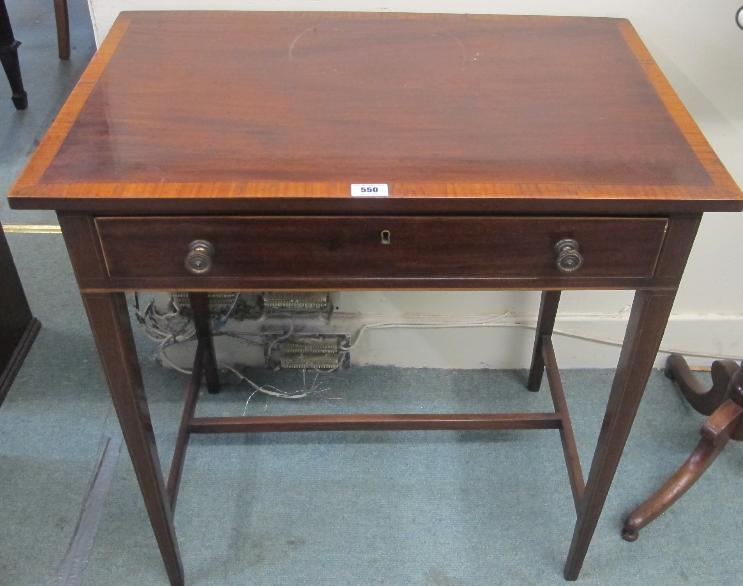 An Edwardian side table with leather pull out writing slope