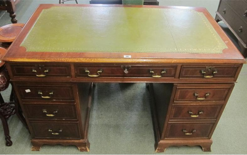 A contemporary pedestal desk with leather top
