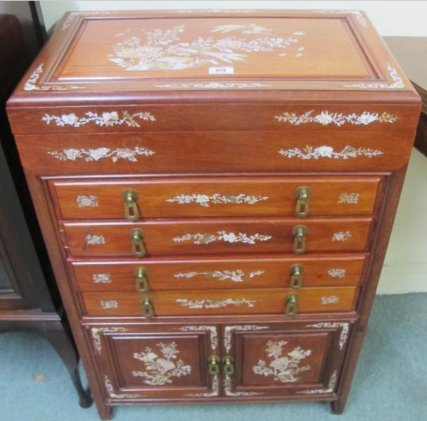 A modern Chinese hardwood and mother of pearl inlaid four drawer chest
