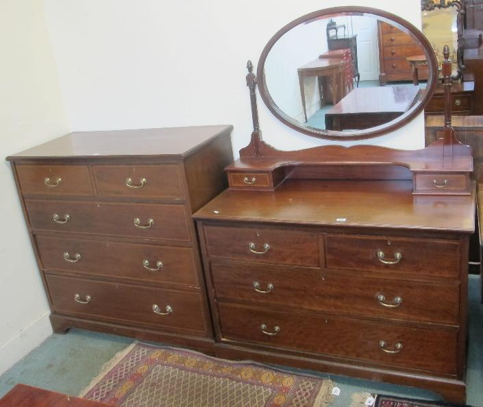 An Edwardian mahogany two over three chest of drawers and dresser