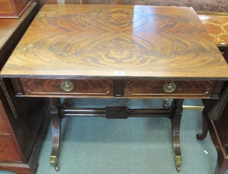 A reproduction sofa mahogany table