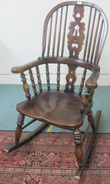An oak octagonal topped occasional table with bobbin supports
