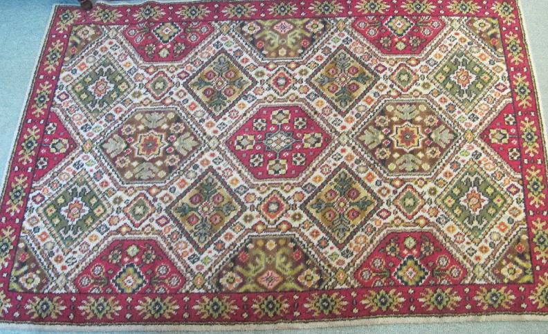 A floral rug on a cream and red ground, 6ft x 4ft