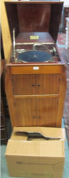 A Unitone mahogany cased gramophone and a box of records
