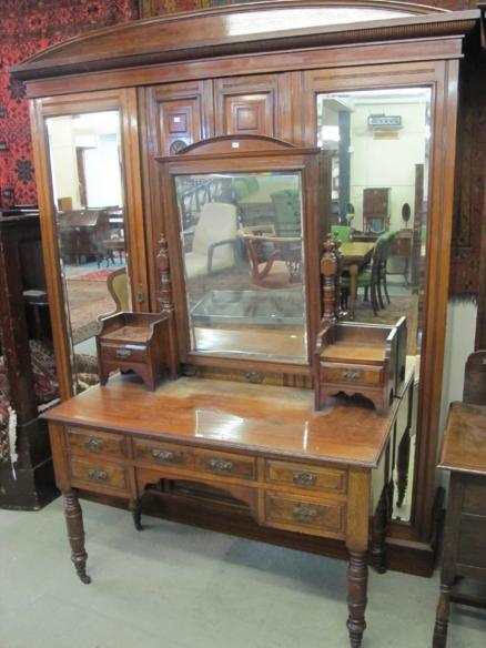 A late Victorian walnut wardrobe and dressing table