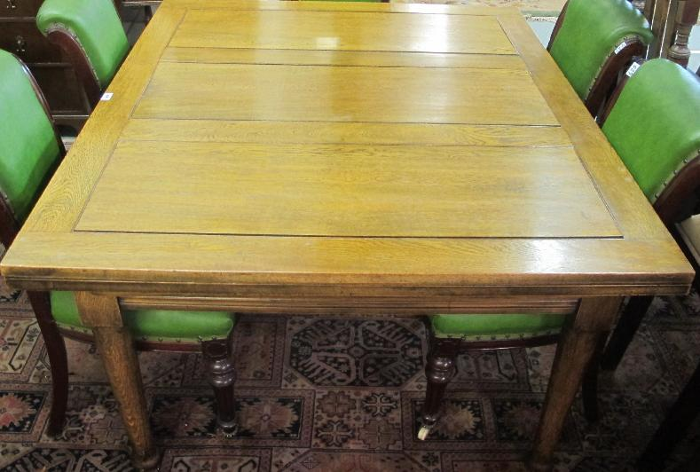 An oak pull out dining table