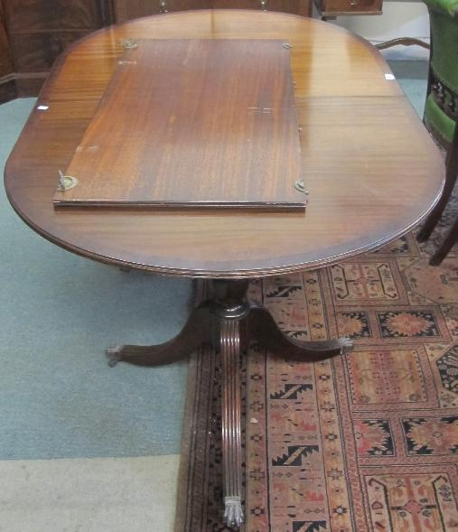 A mahogany brass inlaid D-end dining table