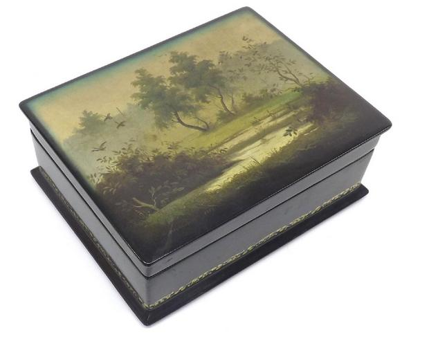 Russian style lacquered box, the lid painted with a riverside landscape with ducks and red interior