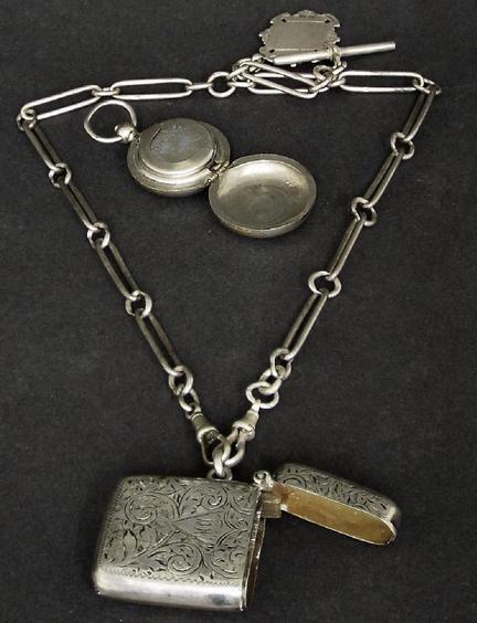 Victorian silver vesta case on a silver chain with pendant; together with a sovereign case