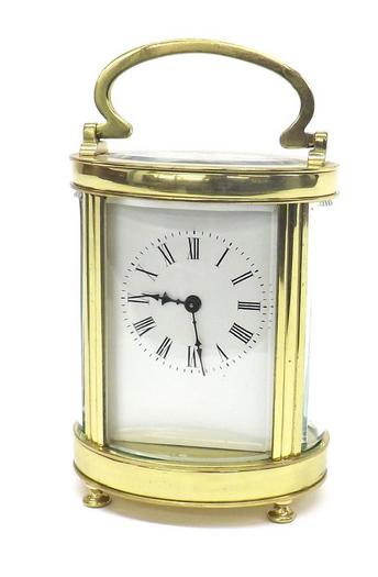 Good oval brass and bevelled glass carriage clock
