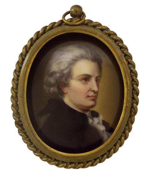 Continental hand painted oval porcelain portrait of Schubert, within a gilded rope twist frame