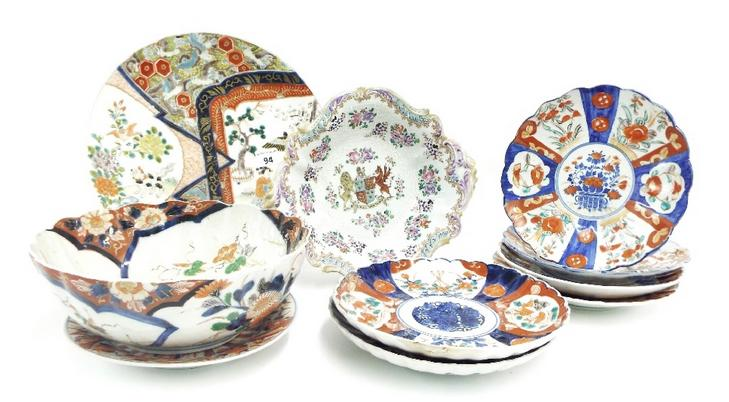 Nine pieces of Japanese Imari porcelain, mainly plates and one fruit bowl