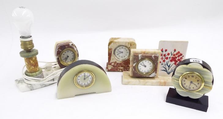 Collection of five various Art Deco wind-up novelty onyx and hardstone clocks
