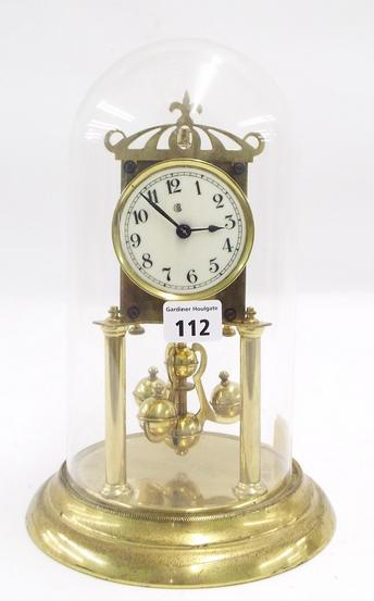 Brass torsion clock under a glass dome