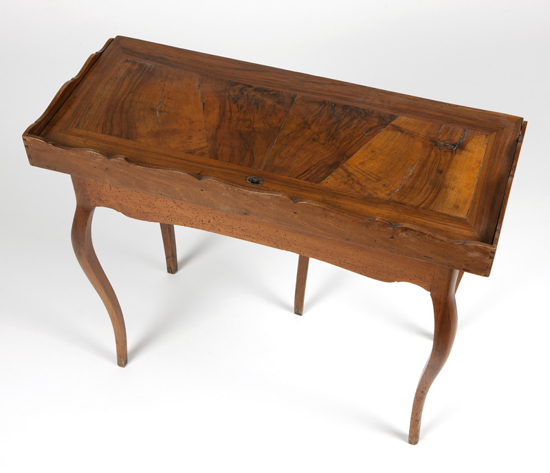 A French Provincial flip-top game table