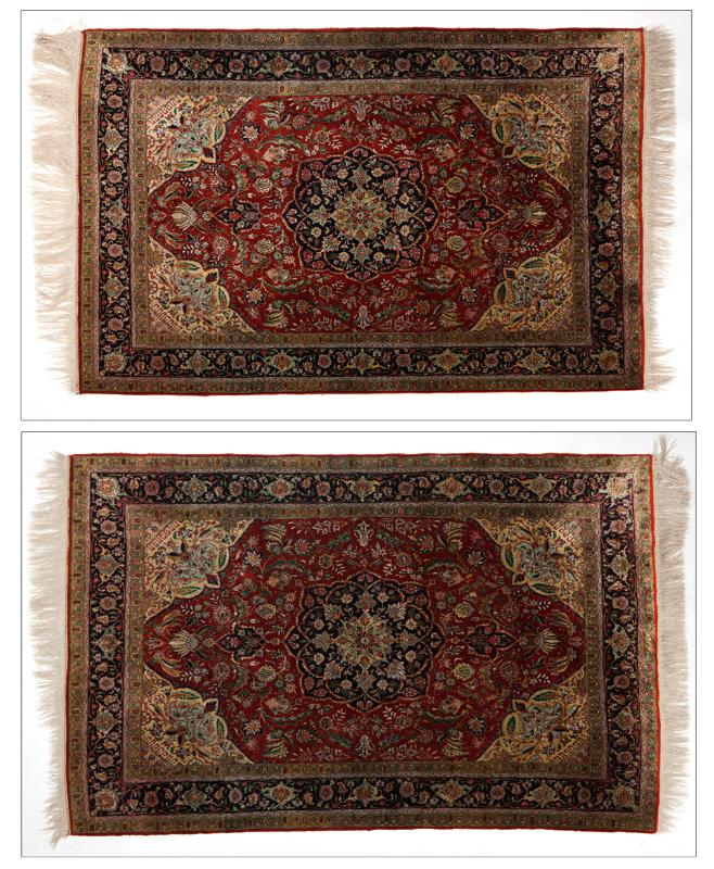 A pair of Persian Isfahan carpets