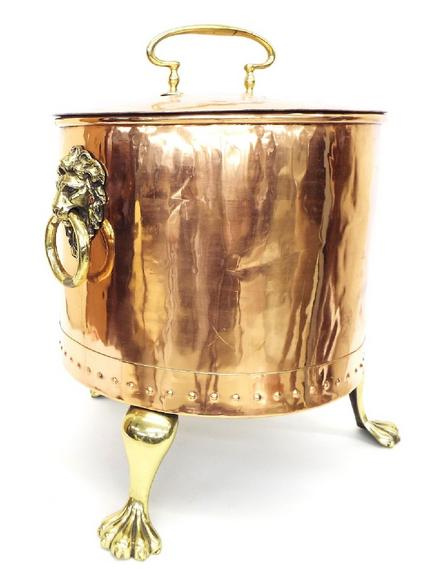 19th century polished copper and brass lidded coal/log bin with twin lion head handles and three paw feet