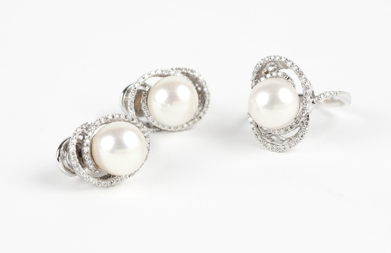 A set of diamond and cultured pearl jewelry