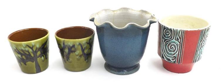 Pair of Poole Pottery plant pots decorated with trees upon an olive green ground, marked ABE493 to base
